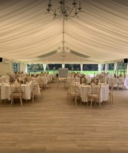 luxury event venue hire - spacious event structure with beautiful wool effect flooring and clean crisp ivory lining