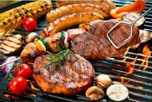 Ace Tones' Mobile BBQ hire - steak, sausages, corn on the cob, mushrooms and other vegetables sizzling on a hot grill